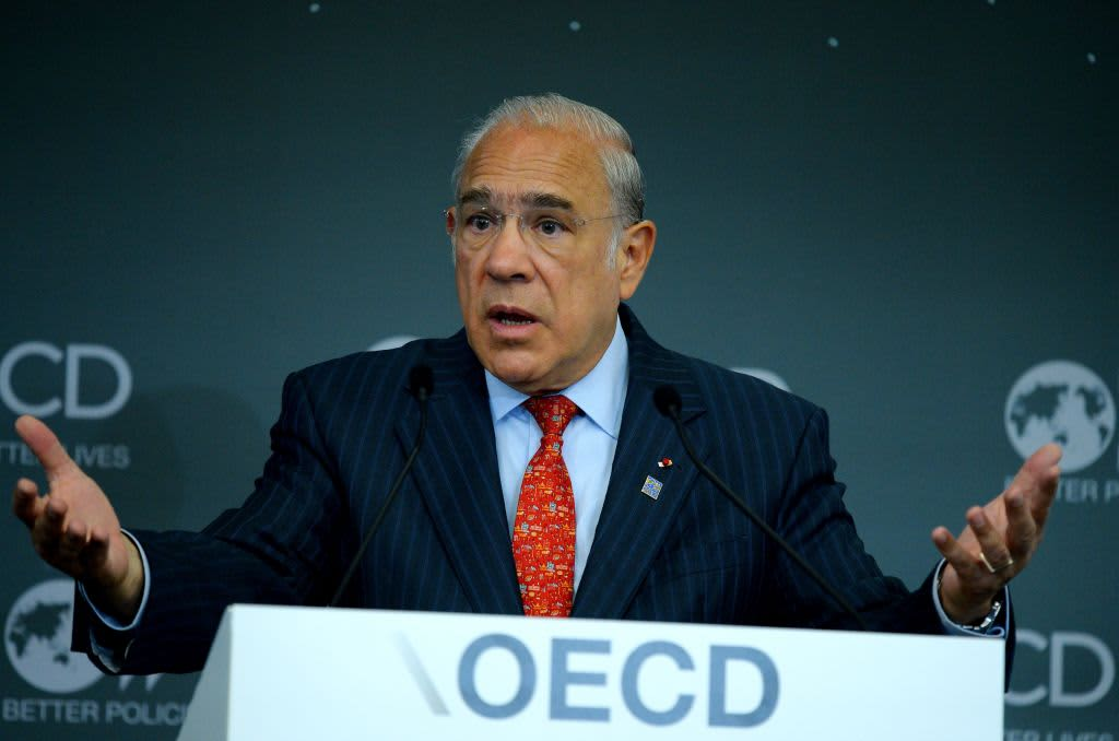 Global trade is likely contracting and we're now 'betting' on a US-China deal, OECD chief says
