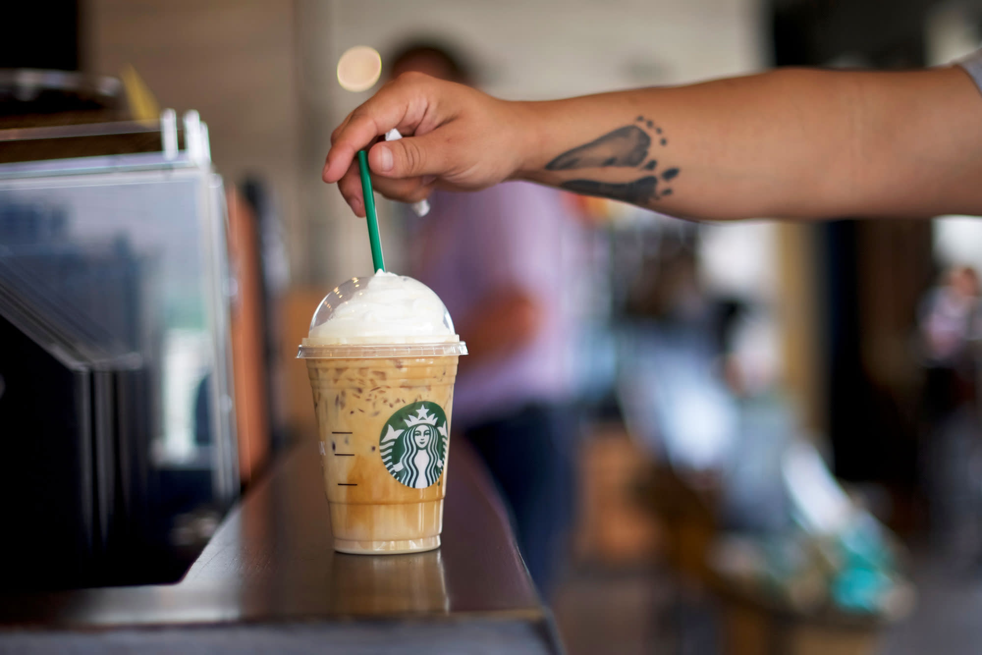 Starbucks and Dunkin' are 'defying the bears' — purchase on a dip: Cramer