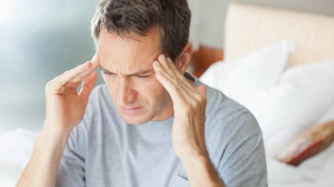 Premium: Man suffering migraine headache