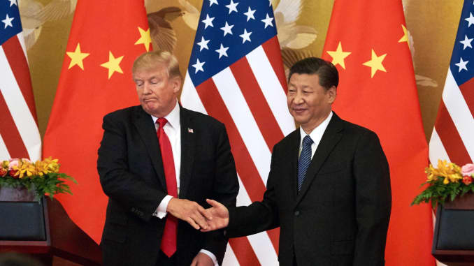 US President Donald Trump (L) and China's President Xi Jinping shake hands at a press conference following their meeting outside the Great Hall of the People in Beijing.