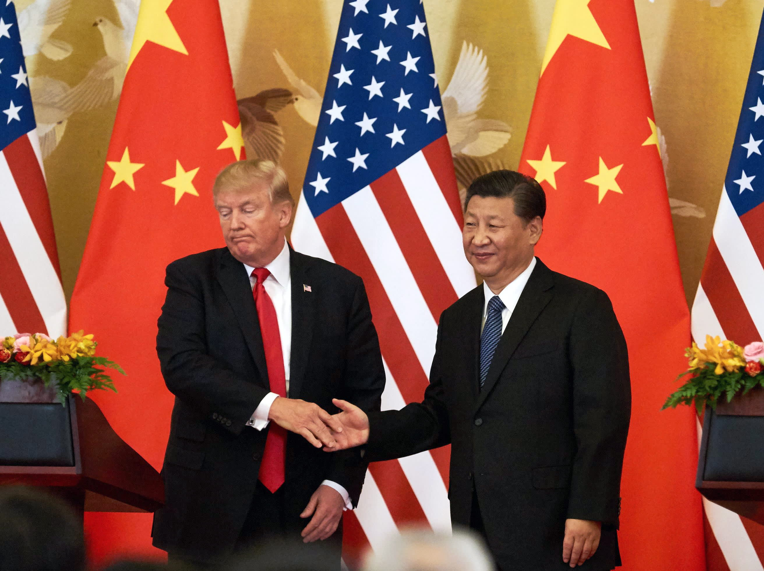 President Donald Trump and China's President Xi Jinping shake hands at a press conference following their meeting outside the Great Hall of the People in Beijing last November.