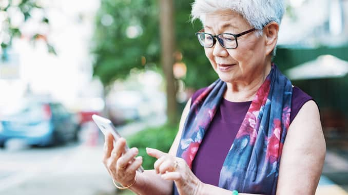 Premium: Senior woman with mobile phone
