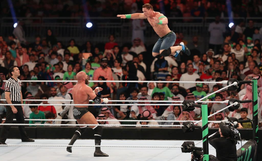 John Cena (R) competes with Triple H during the World Wrestling Entertainment (WWE) Greatest Royal Rumble event in the Saudi coastal city of Jeddah on April 27, 2018.