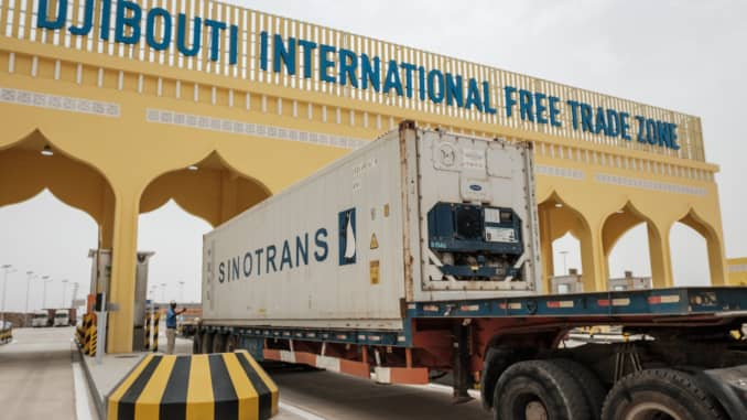 A container truck passes the main gate of Djibouti International Free Trade Zone after an inauguration ceremony in Djibouti on July 5, 2018.