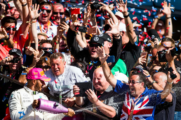 Fans greet racer Lewis Hamilton of Mercedes and Great Britain during the United States Formula One Grand Prix in 2017.