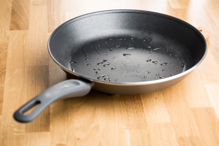 GP: Teflon frying pan on wooden table