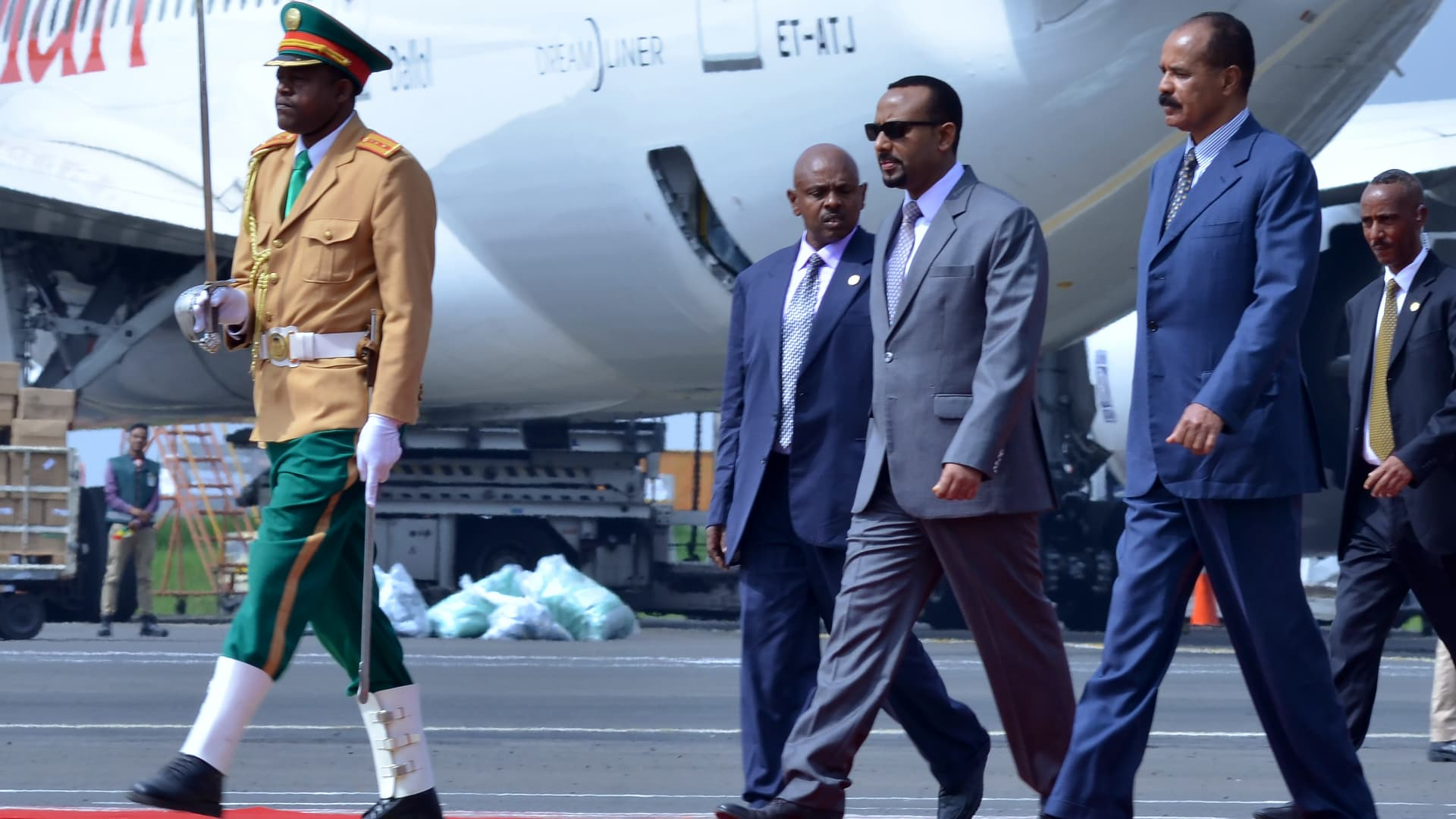 Eritrea's President Isaias Afwerki (second right) is received by Ethiopia's Prime Minister Abiy Ahmed (third right) as he arrives at Bole International airport in Addis Ababa on July 14, 2018.