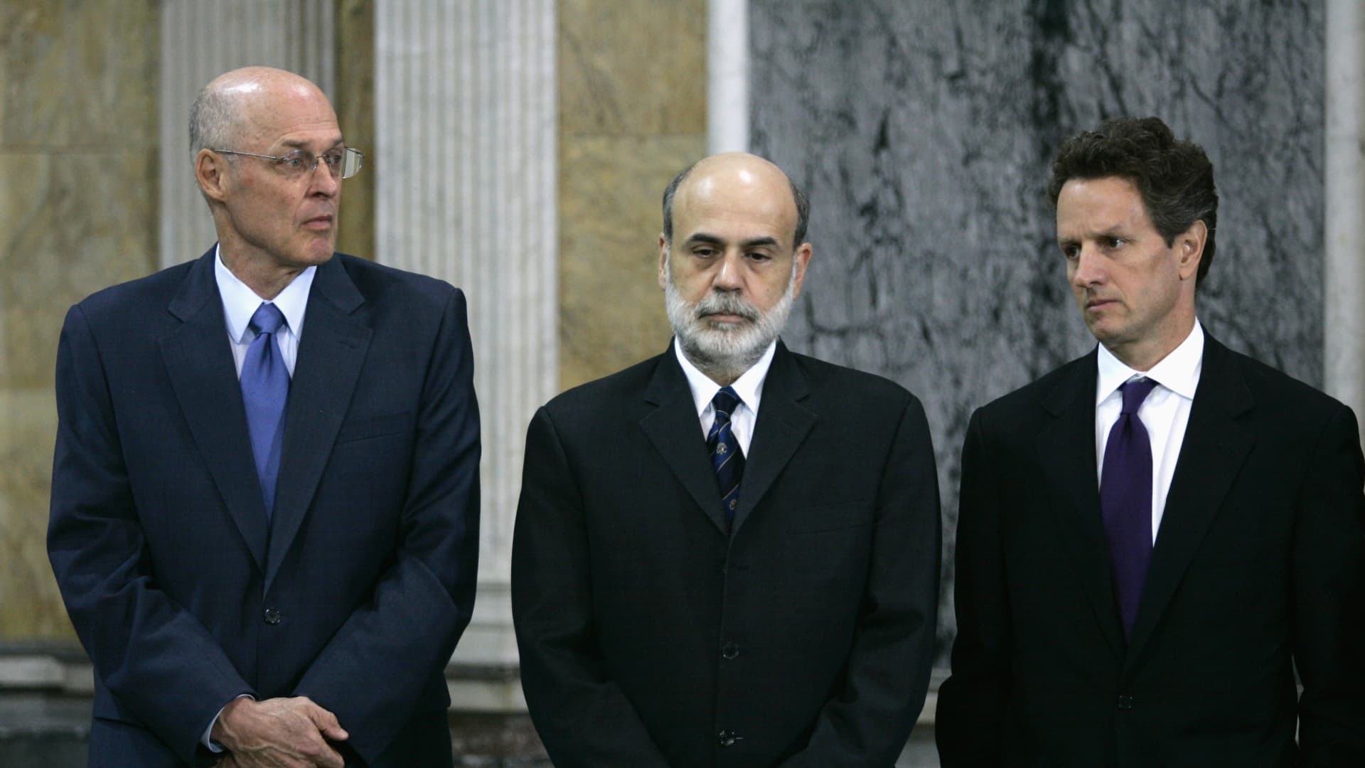 U.S. Treasury Secretary Henry Paulson (L), Federal Reserve Chairman Ben Bernanke (C) and President and CEO of the Federal Reserve Bank of New York Timothy F. Geithner listen as FDIC Chairman Sheila Bair (not pictured) speaks at the Treasury Department Cash Room in Washington, October 14, 2008.