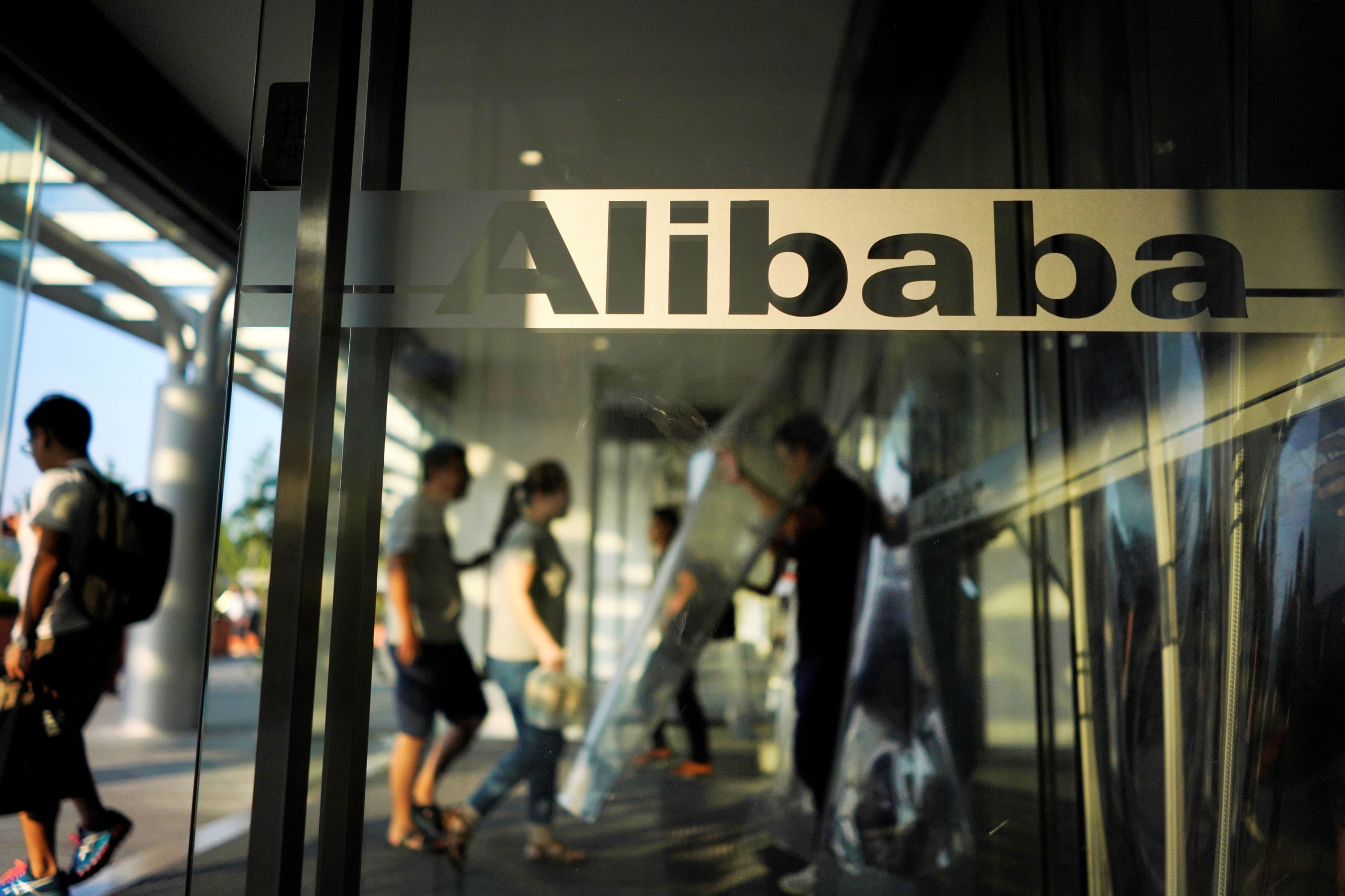 China to place government officials inside 100 private companies, including Alibaba