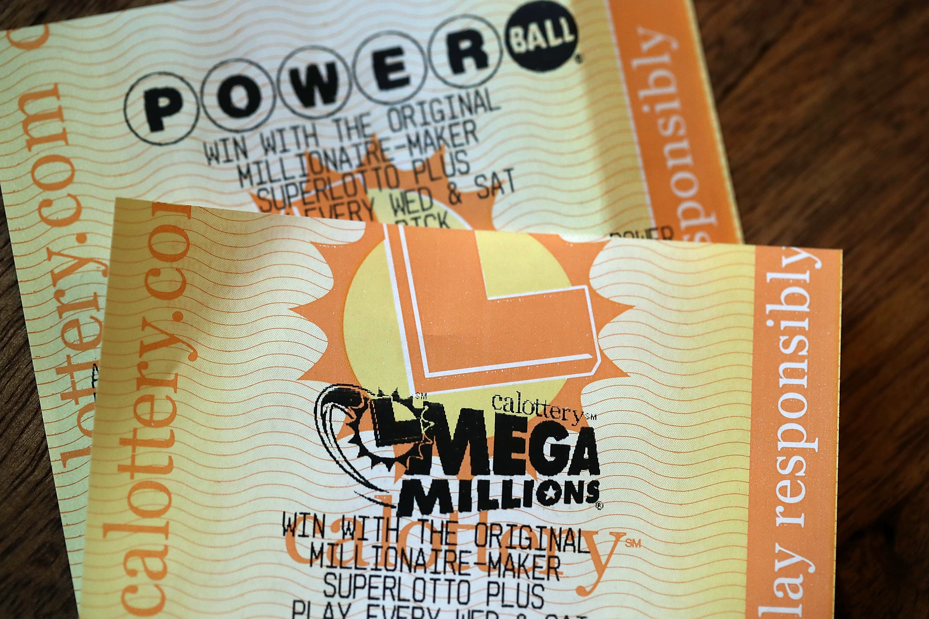 Powerball and Mega Millions lottery tickets are displayed.