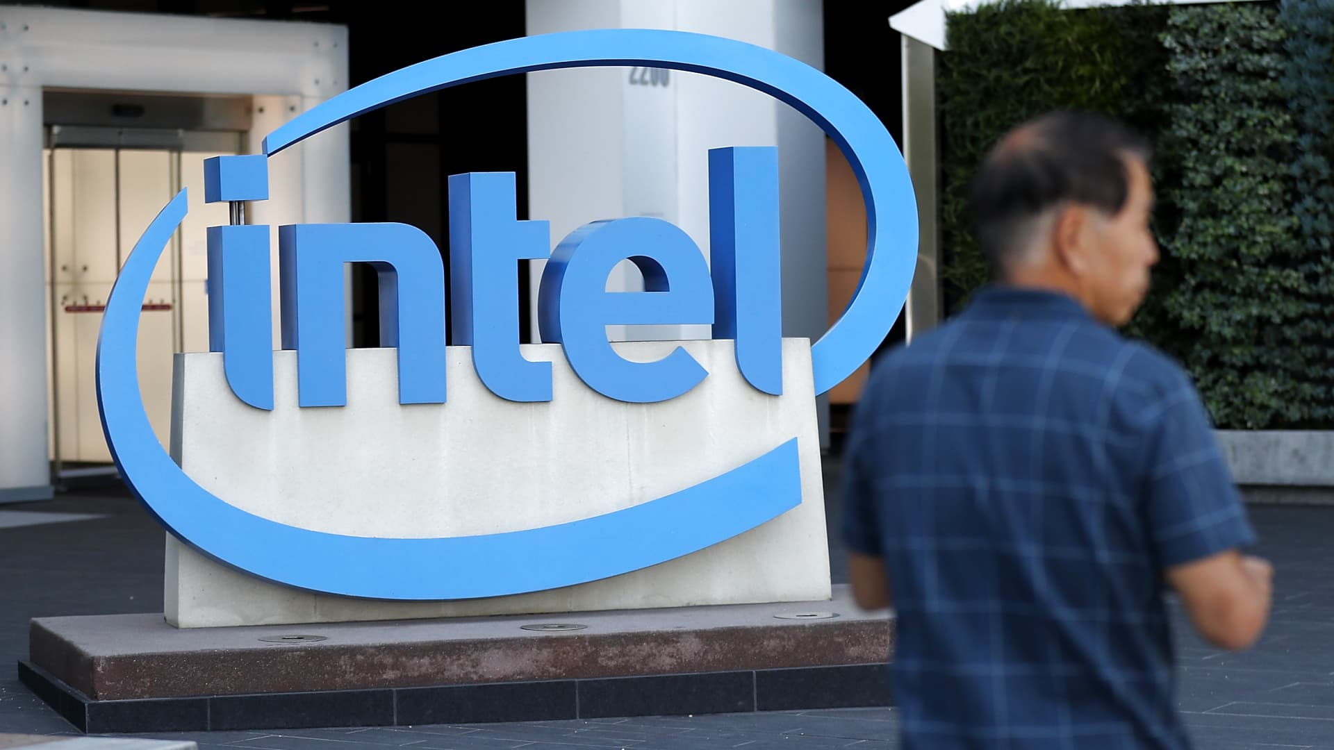 The Intel logo is displayed outside of the Intel headquarters in Santa Clara, Calif.