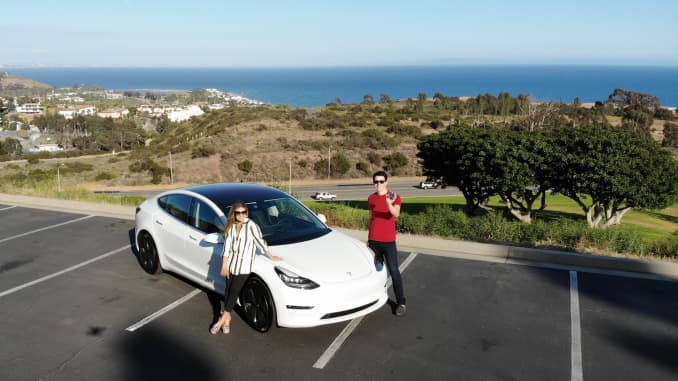 Keith Rosso and his wife Liz with their new Tesla Model 3
