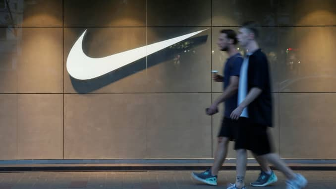 RT: Nike logo and pedestrians