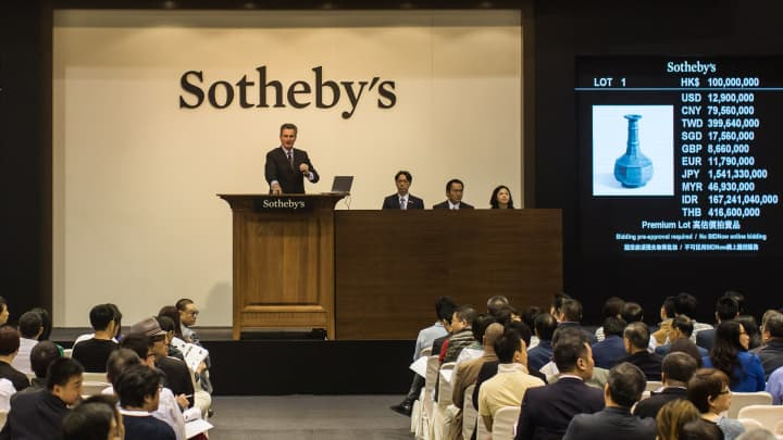 Sotheby's auction house is being taken private by group controlled by art collector Patrick Drahi