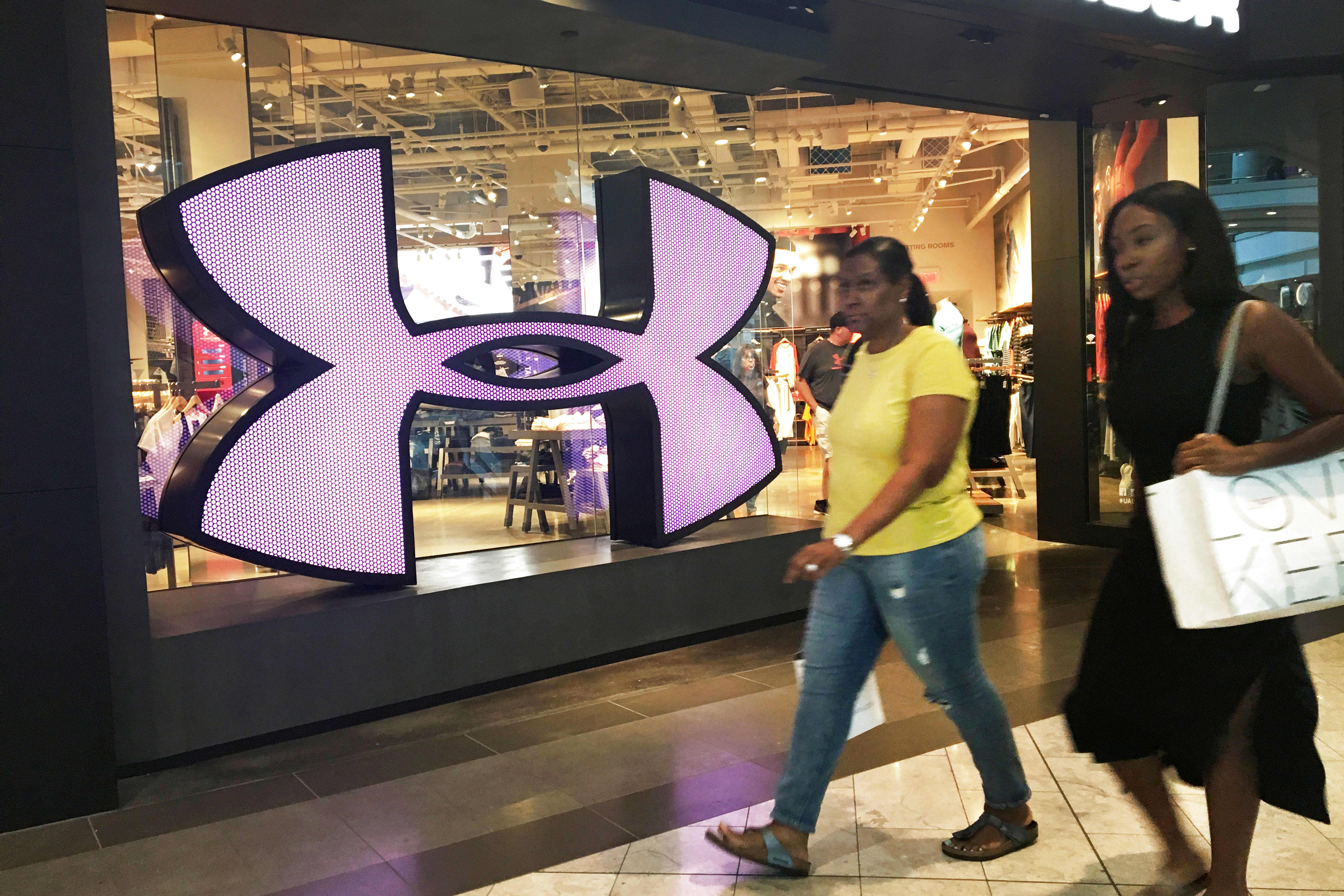 Stocks making the biggest moves midday: Under Armour, T-Mobile, Sprint, Facebook and more