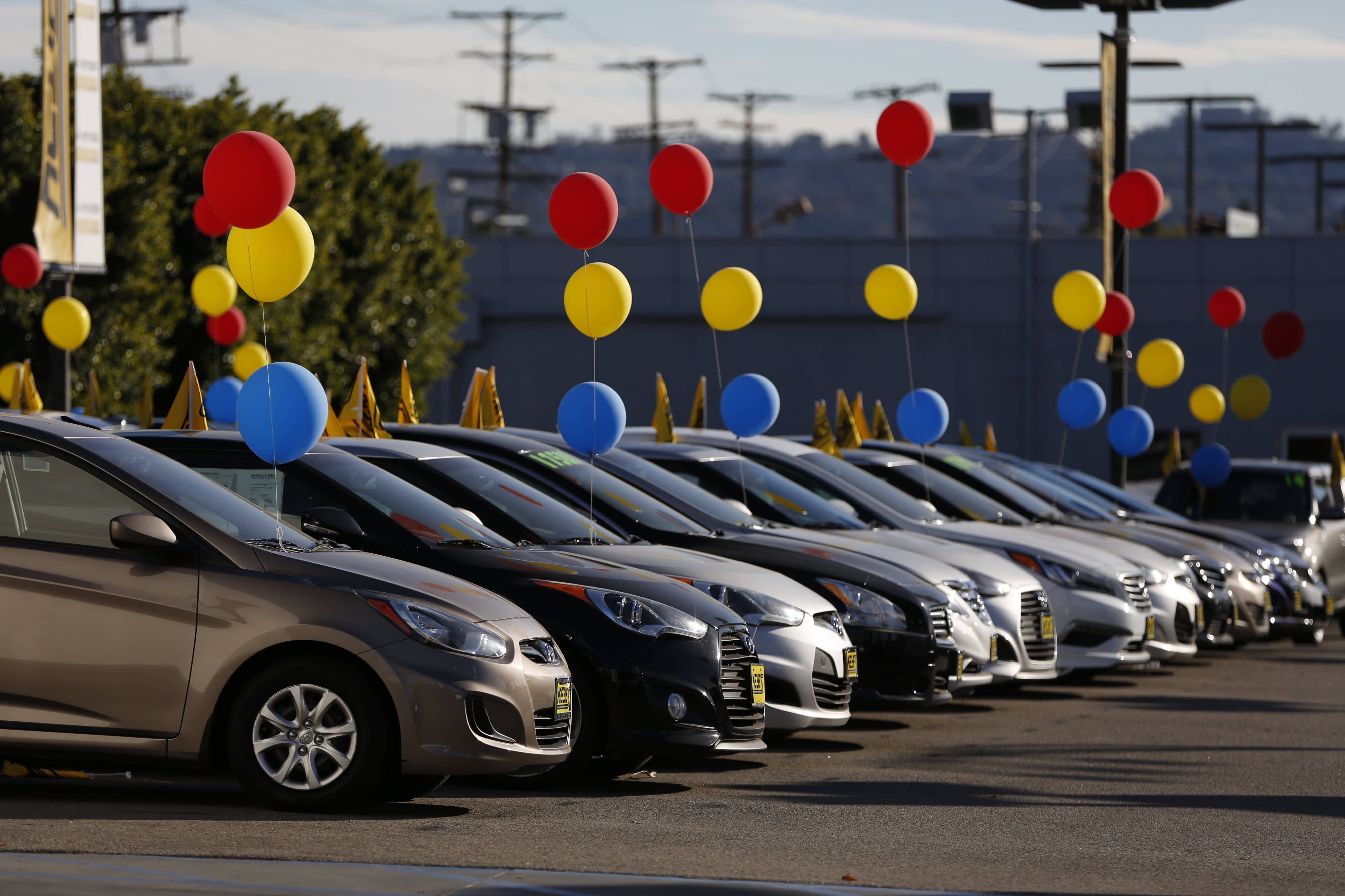 Vehicles sit on display for sale on the lot of the dealership in Los Angeles, California.