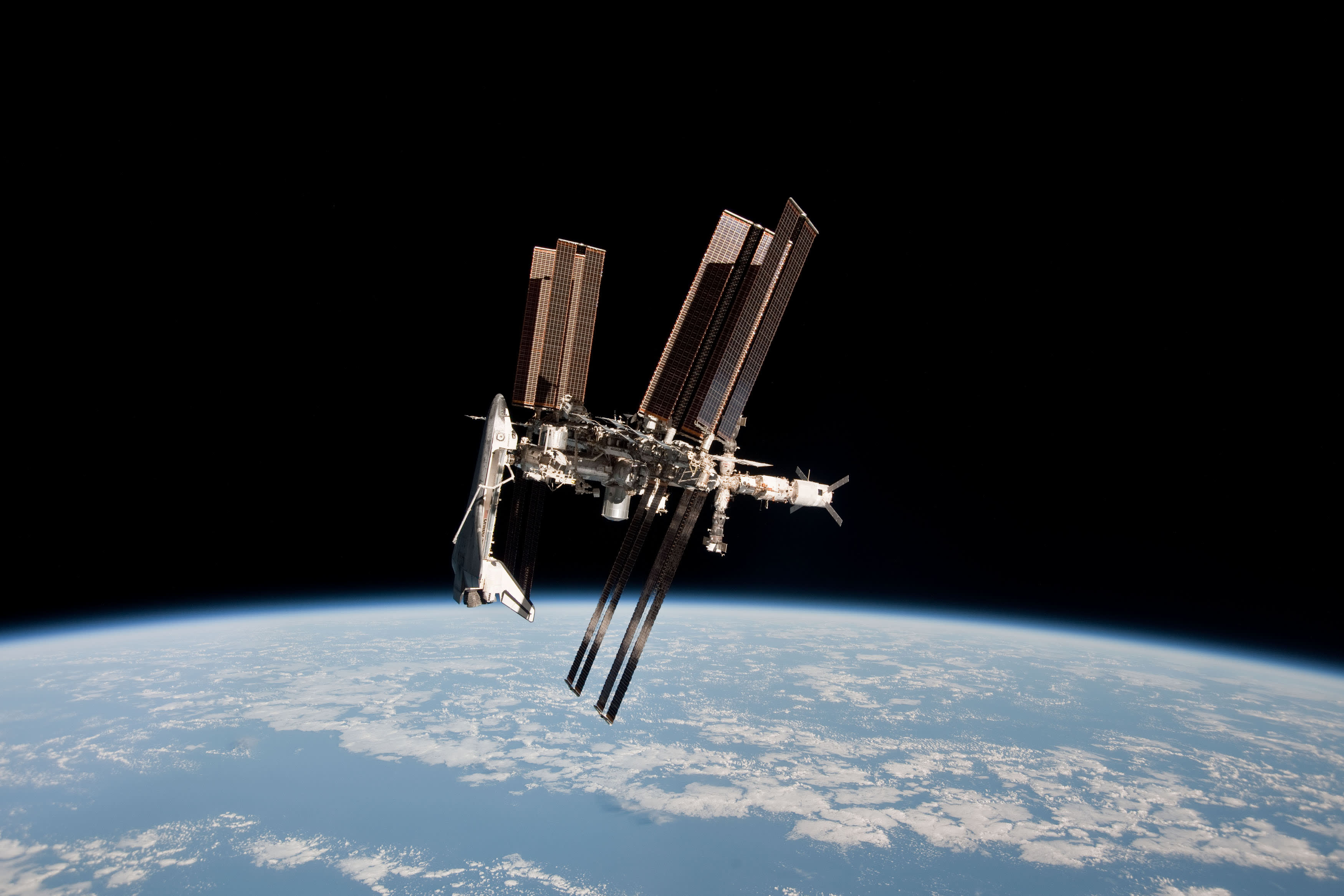 In this handout image provided by the European Space Agency (ESA) and NASA, the International Space Station and the docked space shuttle Endeavour orbit Earth during Endeavour's final sortie in space.