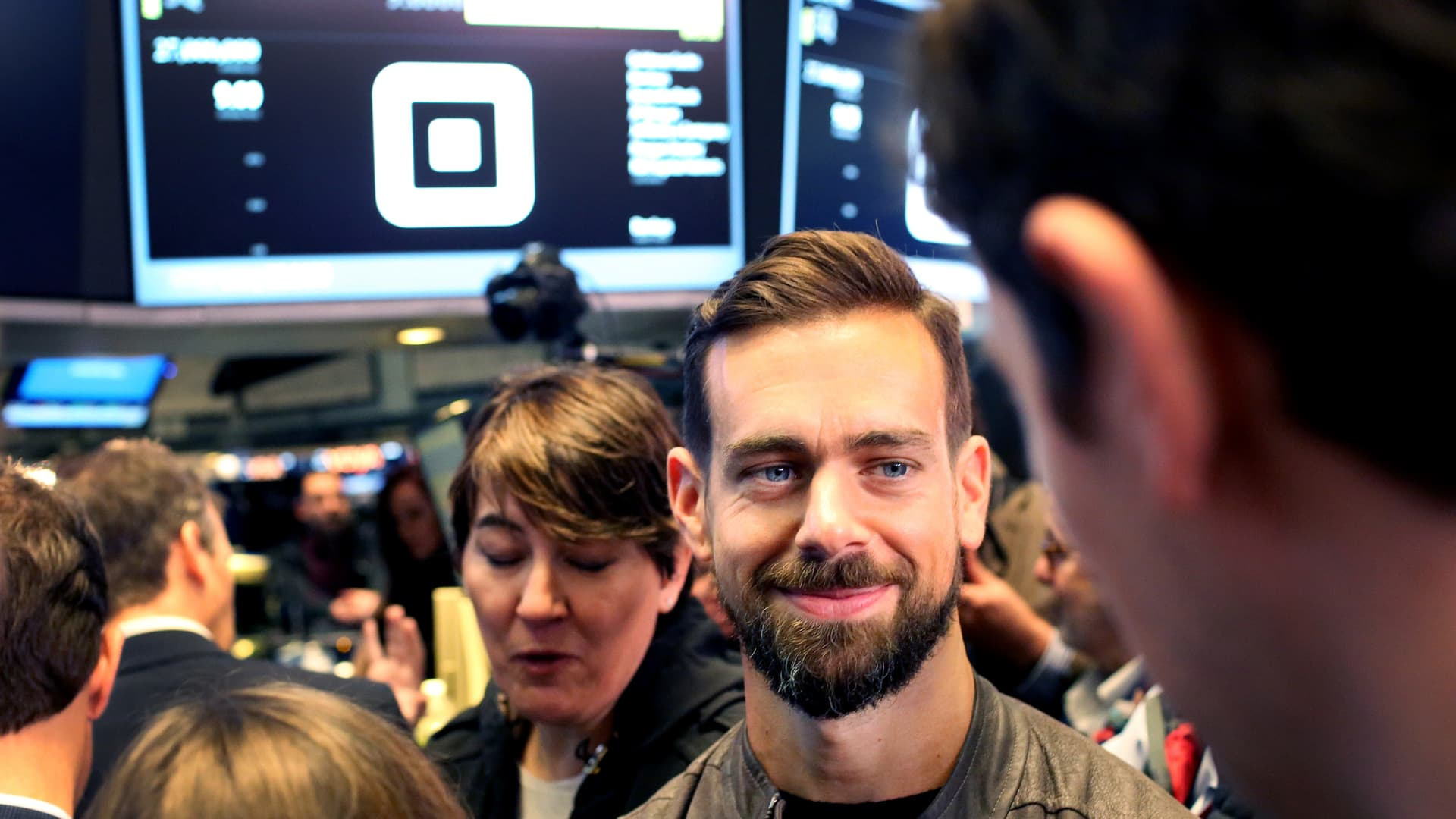 Jack Dorsey, chief executive officer of Square Inc., second right, tours the floor of the New York Stock Exchange (NYSE) in New York, U.S., on Thursday, Nov. 19, 2015.