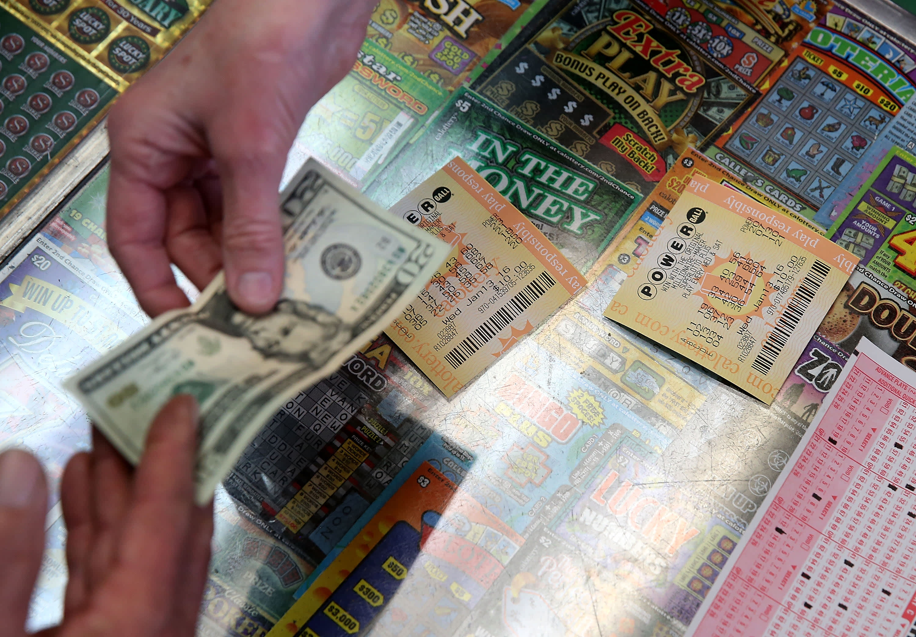 A customer buys Powerball tickets at Kavanagh Liquors on in San Lorenzo, California.