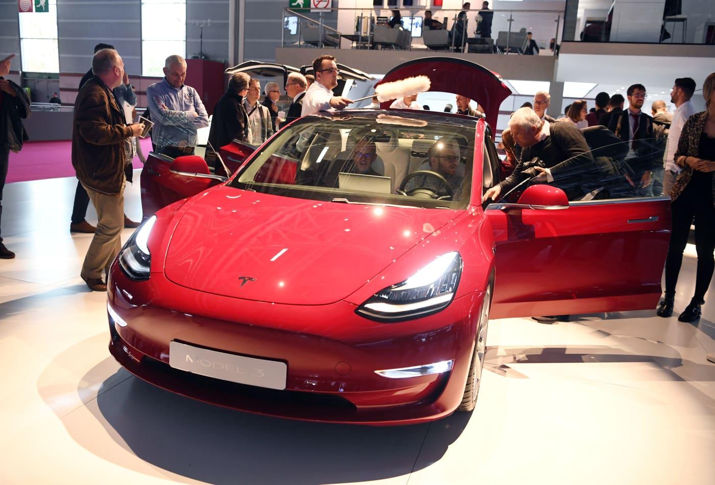 Investors should consider selling some Tesla shares and 'let the rest run,' Jim Cramer says