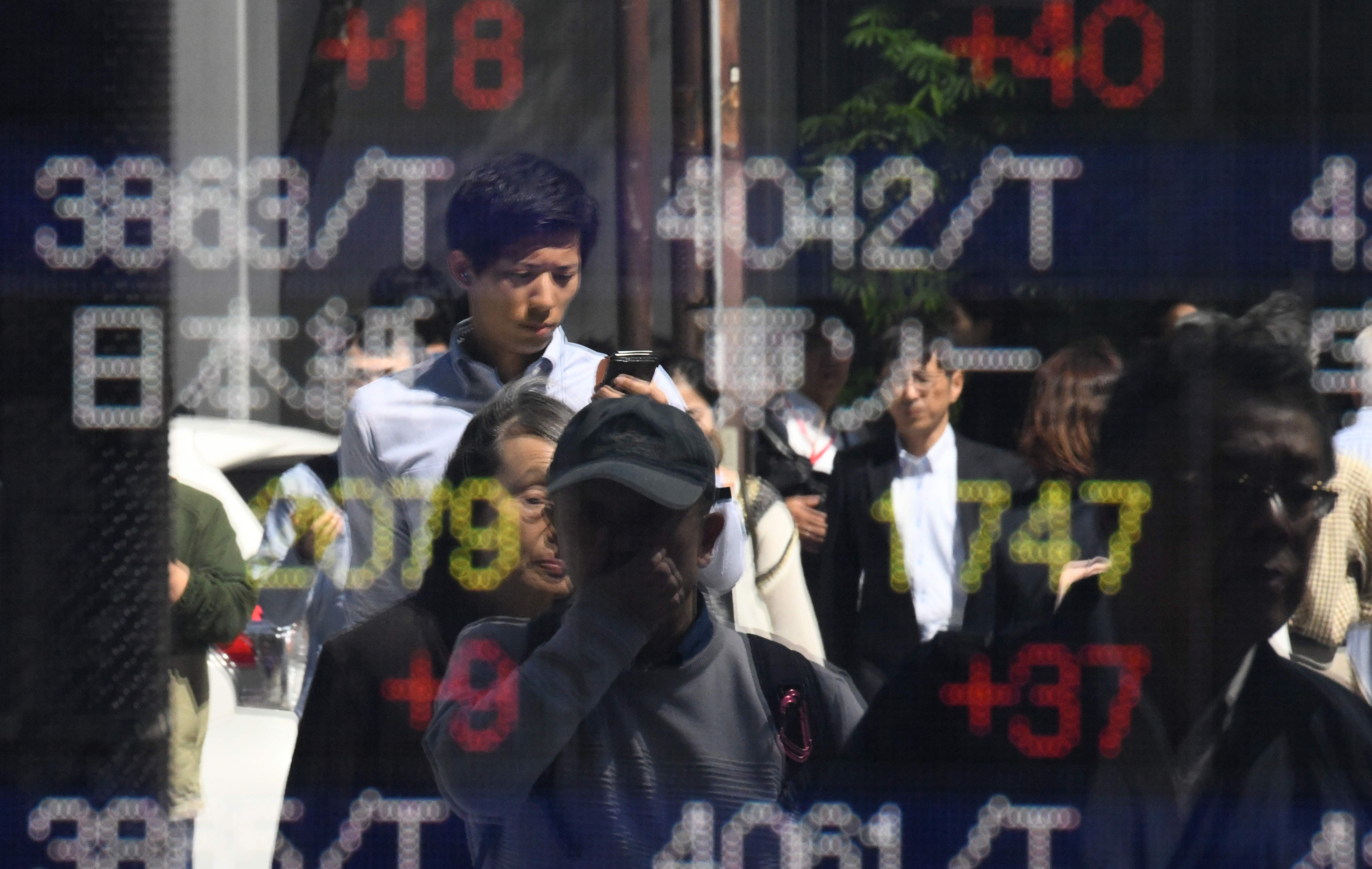 Asia shares trade higher as investors await Chinese inflation numbers, Japan GDP beats expectations