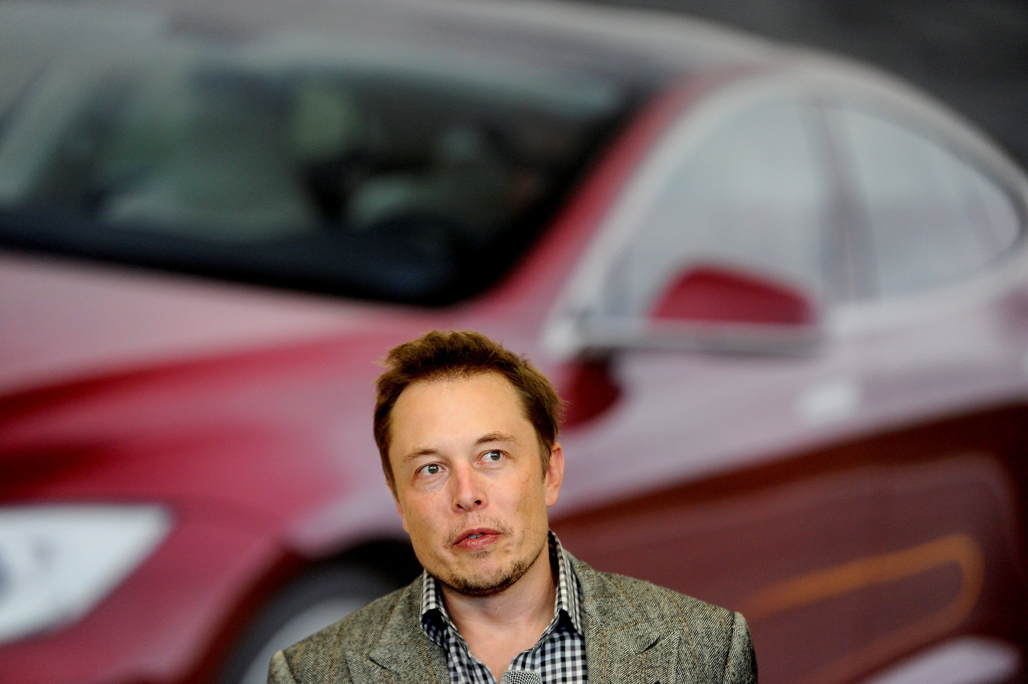 Tesla Chief Executive Office Elon Musk speaks at his company's factory in Fremont, California.
