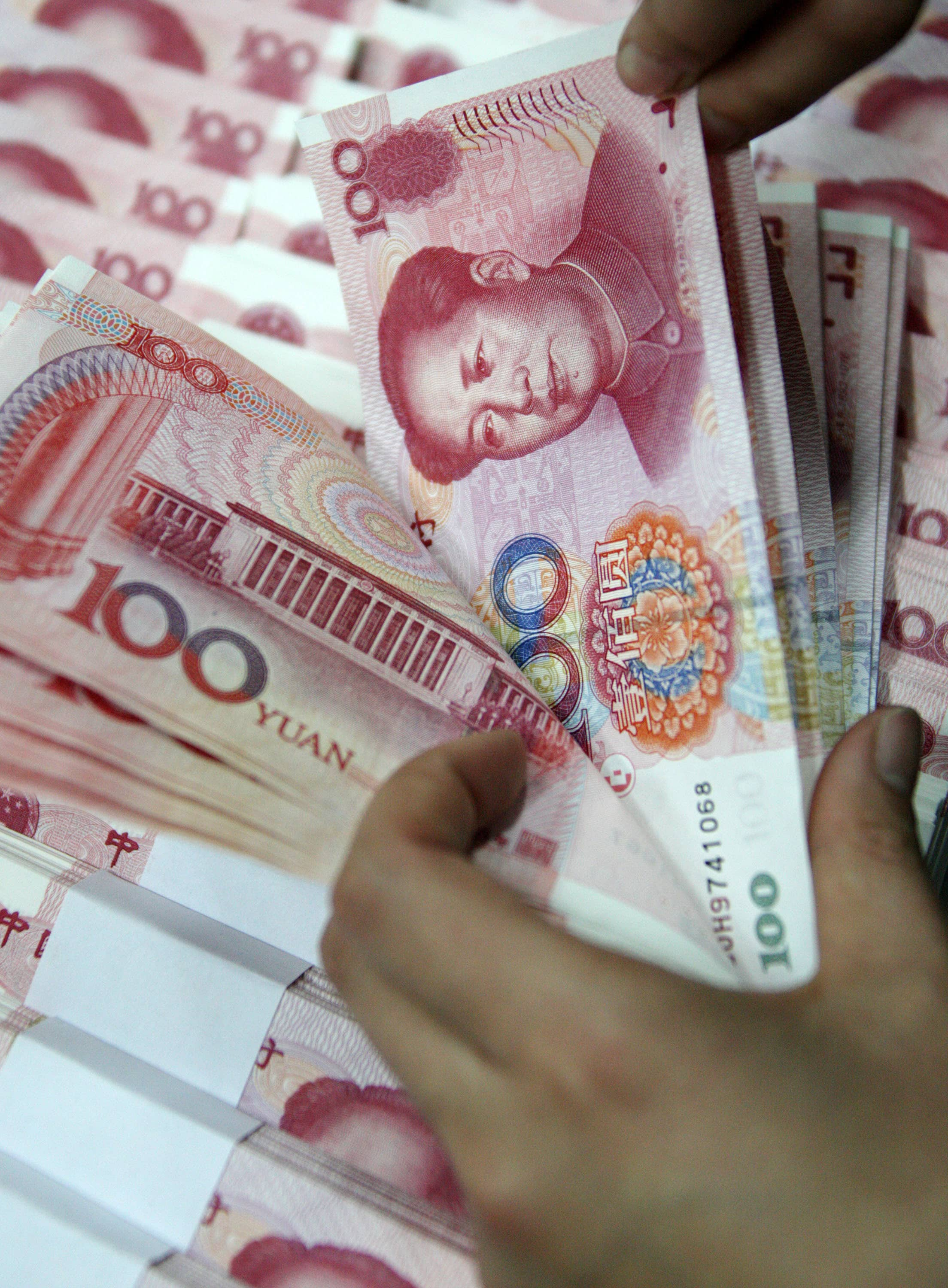 China's central bank denies devaluation is to counter tariffs