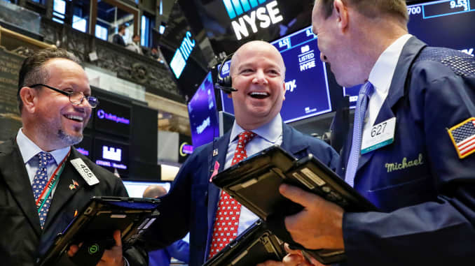 Stocks rebound from last week's losses to set new records