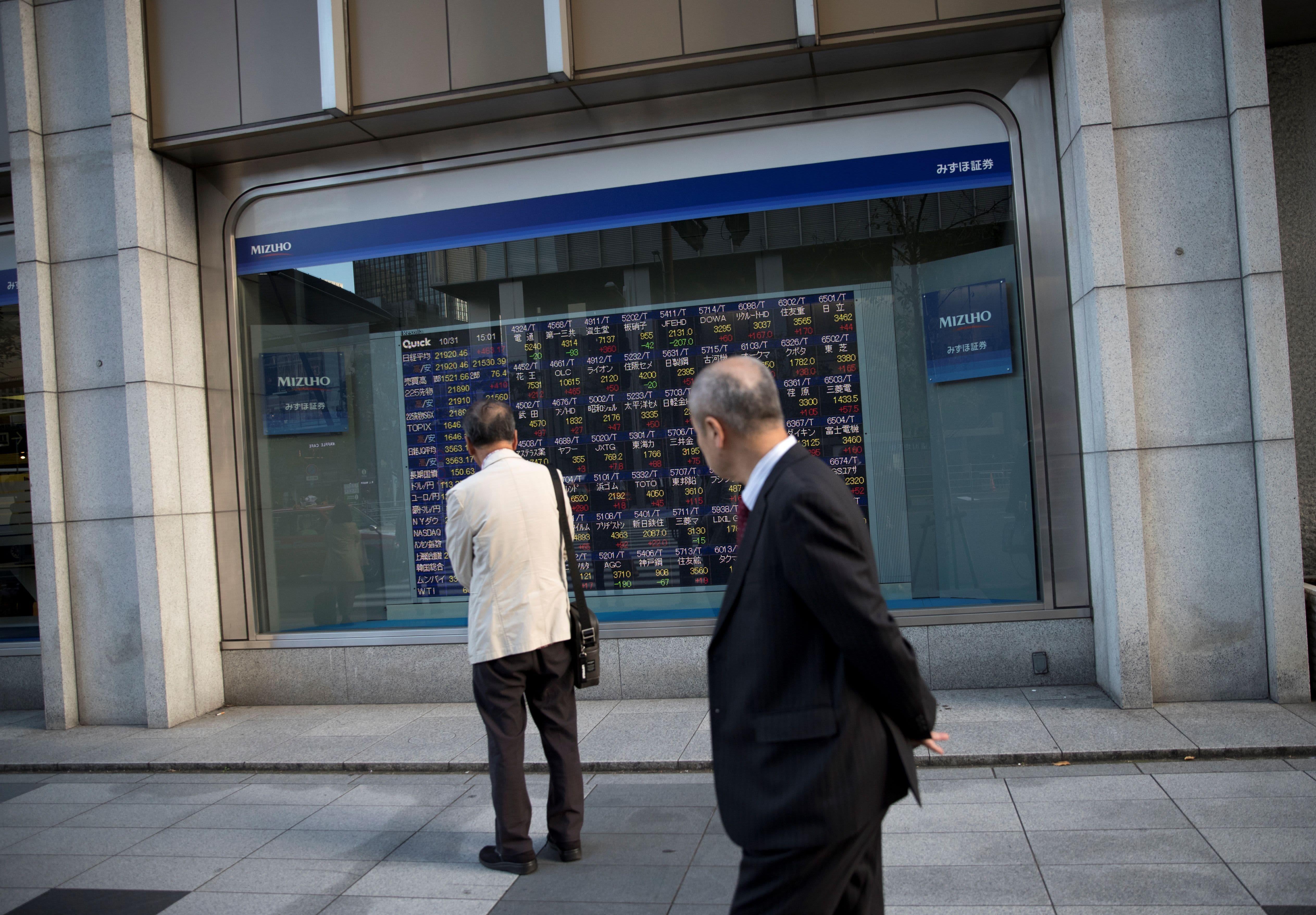 Asia stocks mixed as Japan-South Korea tensions escalate; yuan dips to fresh low