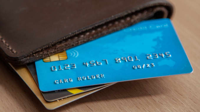 Credit cards in a wallet on wooden table. Open access for online shopping