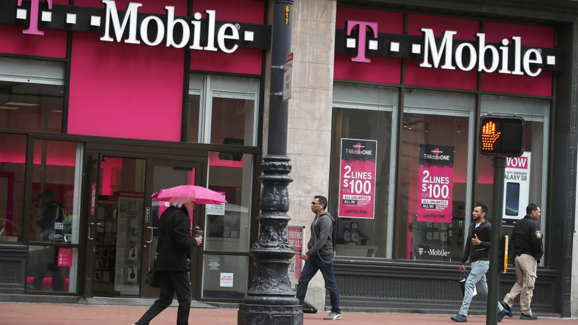 People walk by a T-Mobile store in San Francisco, California