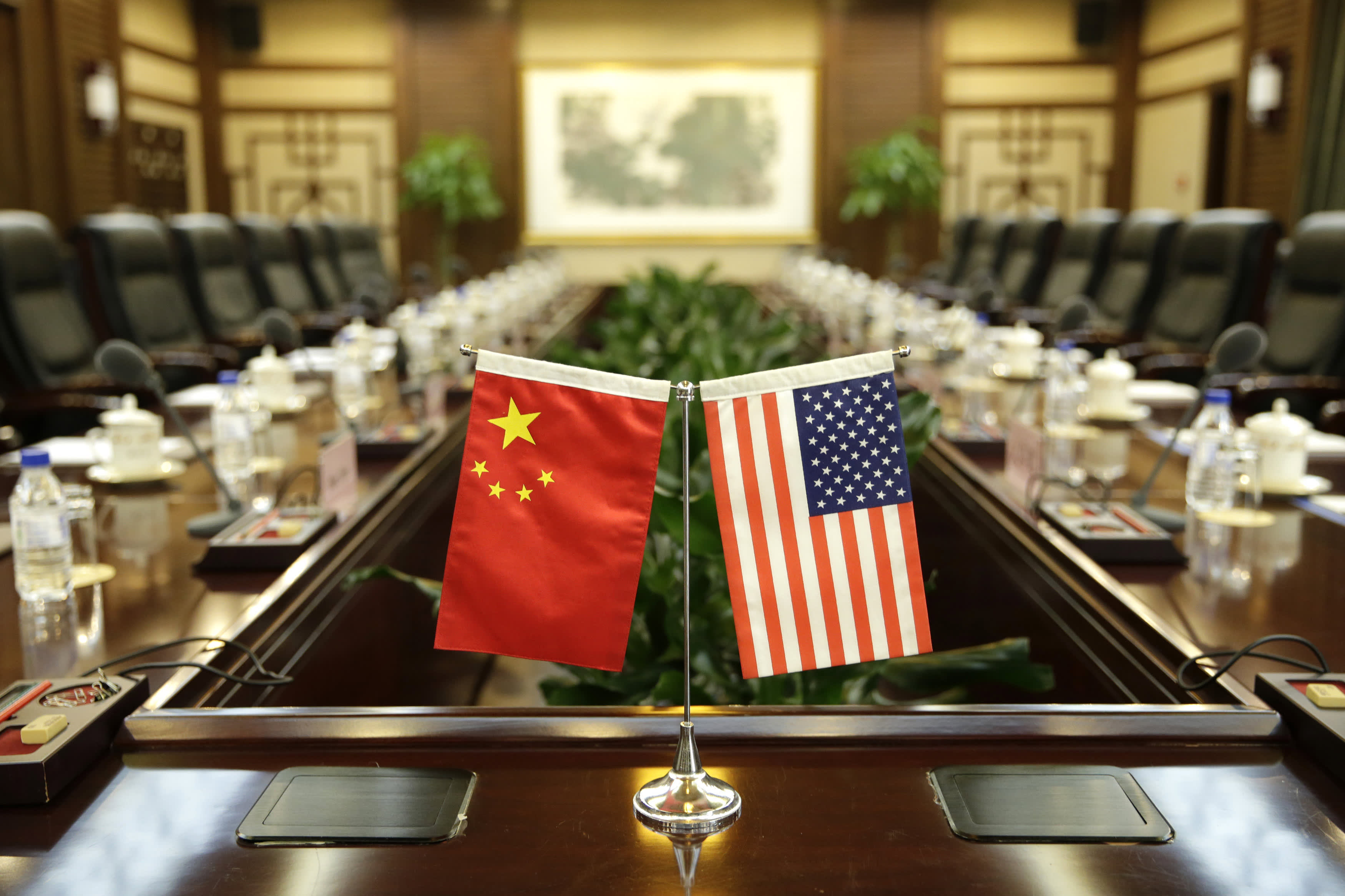 Flags of the US and China are placed ahead of a meeting between US Secretary of Agriculture Sonny Perdue and China's Agriculture Minister Han Changfu at the Ministry of Agriculture in Beijing on June 30, 2017.