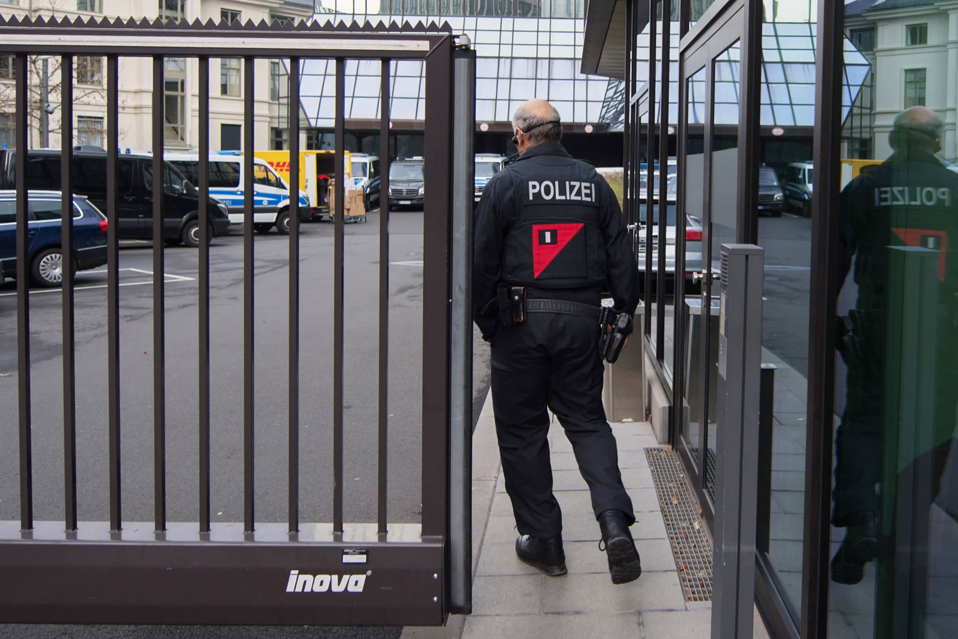 German police raid Deutsche Bank offices on money laundering allegations; shares fall 3.4%