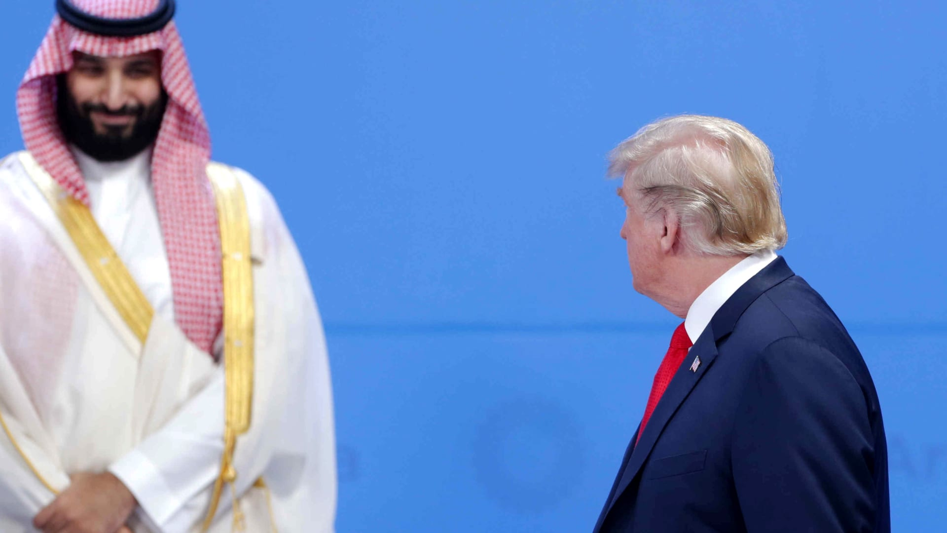 U.S. President Donald Trump looks over at Crown Prince of Saudi Arabia Mohammad bin Salman al-Saud as they line up for the family photo during the opening day of Argentina G20 Leaders' Summit 2018 at Costa Salguero on November 30, 2018 in Buenos Aires, Argentina.