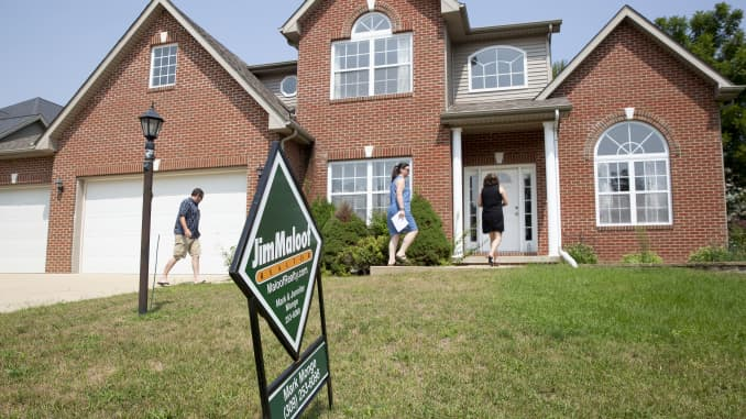 Prospective home buyers arrive with a realtor to a house for sale in Dunlap, Illinois.