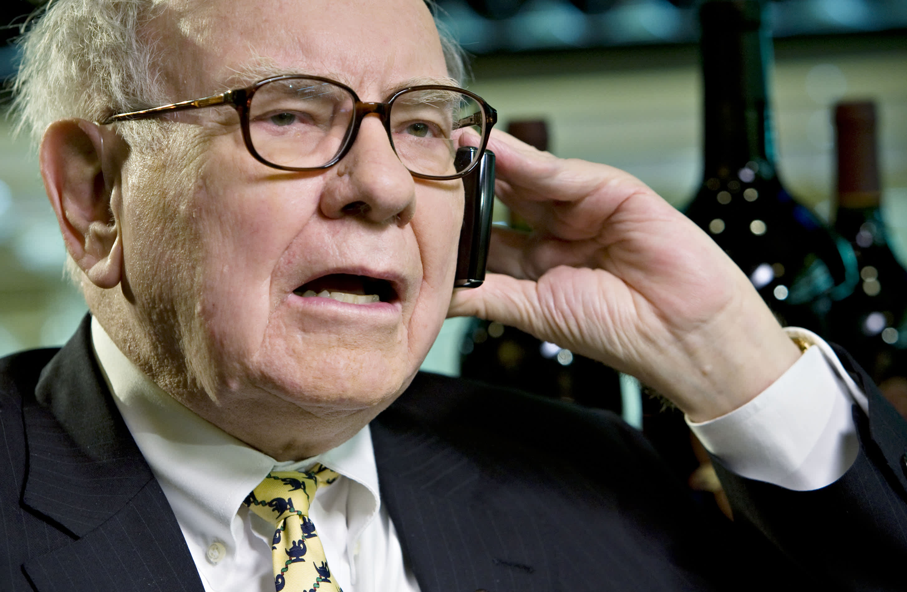 Billionaire investor Warren Buffett, chairman of Berkshire Hathaway, speaks on a mobile phone during an interview in New York, U.S., on Wednesday, June 25, 2008.