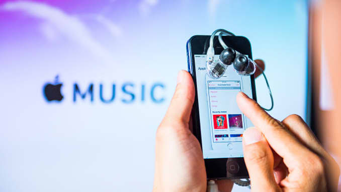 Apple Music has reportedly passed Spotify in paid