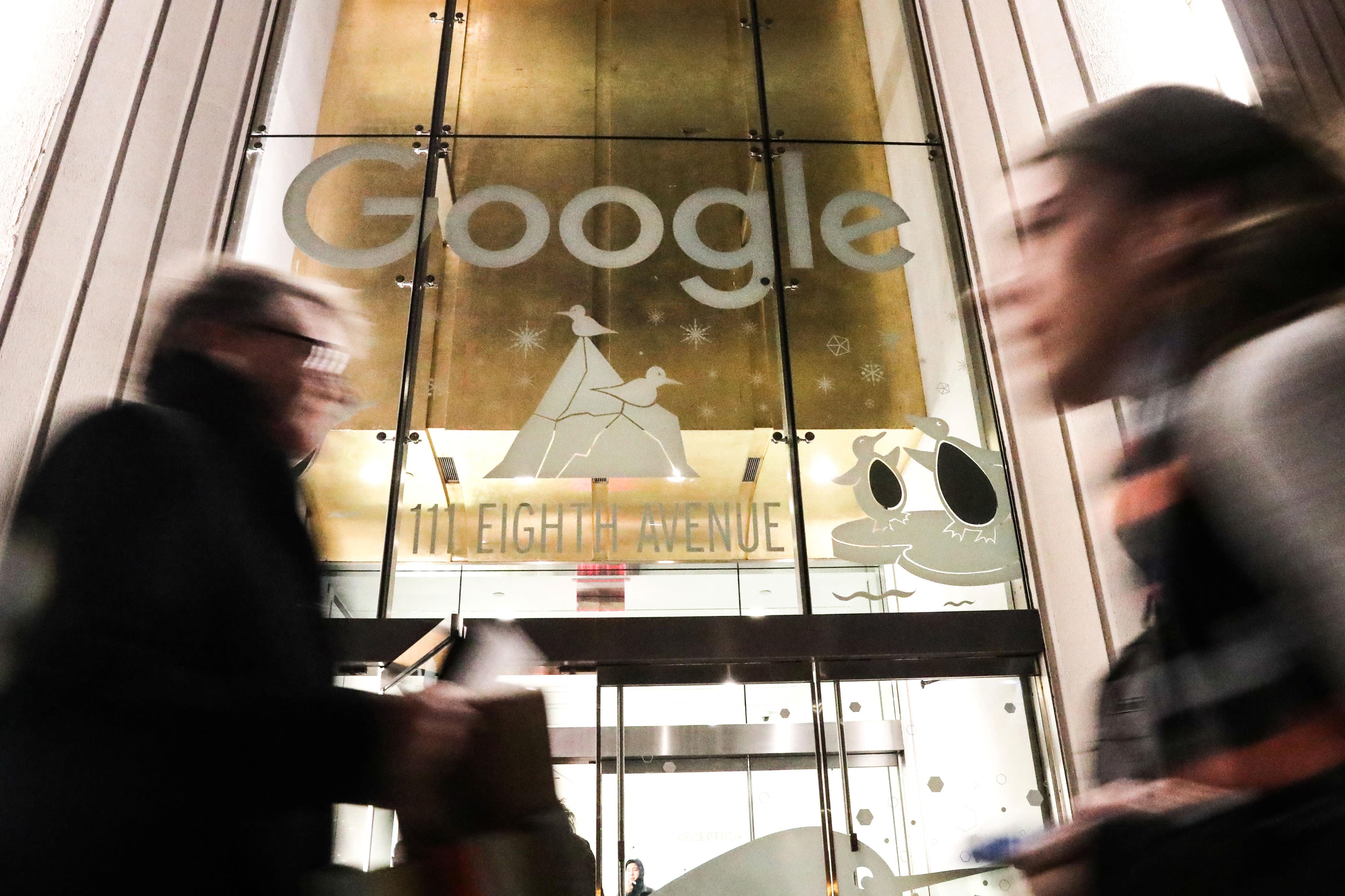 Pedestrians walk past Google headquarters in New York.