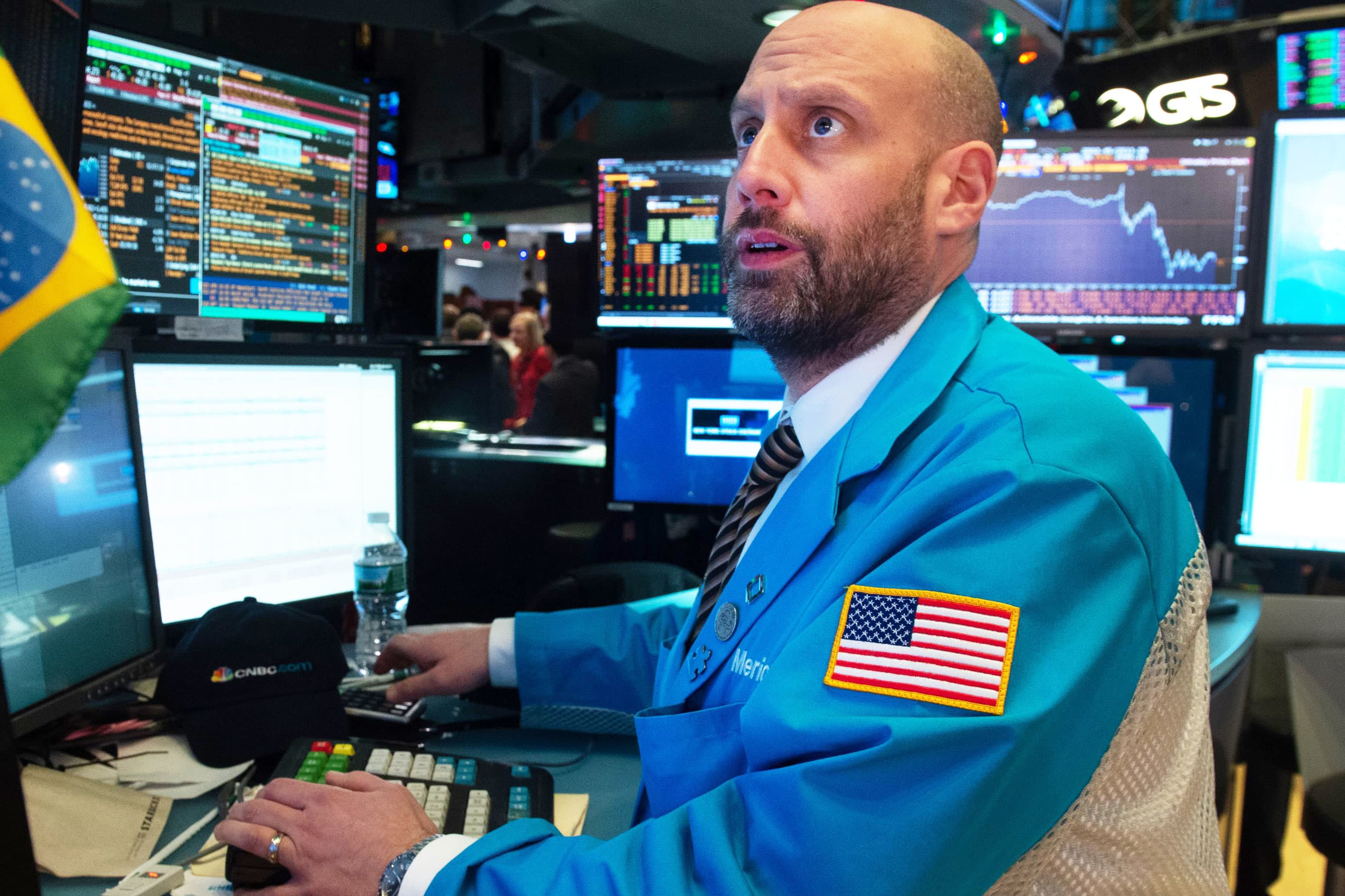 Traders work on the floor at the closing bell at the New York Stock Exchange.