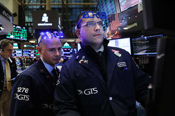 Traders work on the floor of the New York Stock Exchange (NYSE) on the last day of the trading year on December 31, 2018 in New York City.