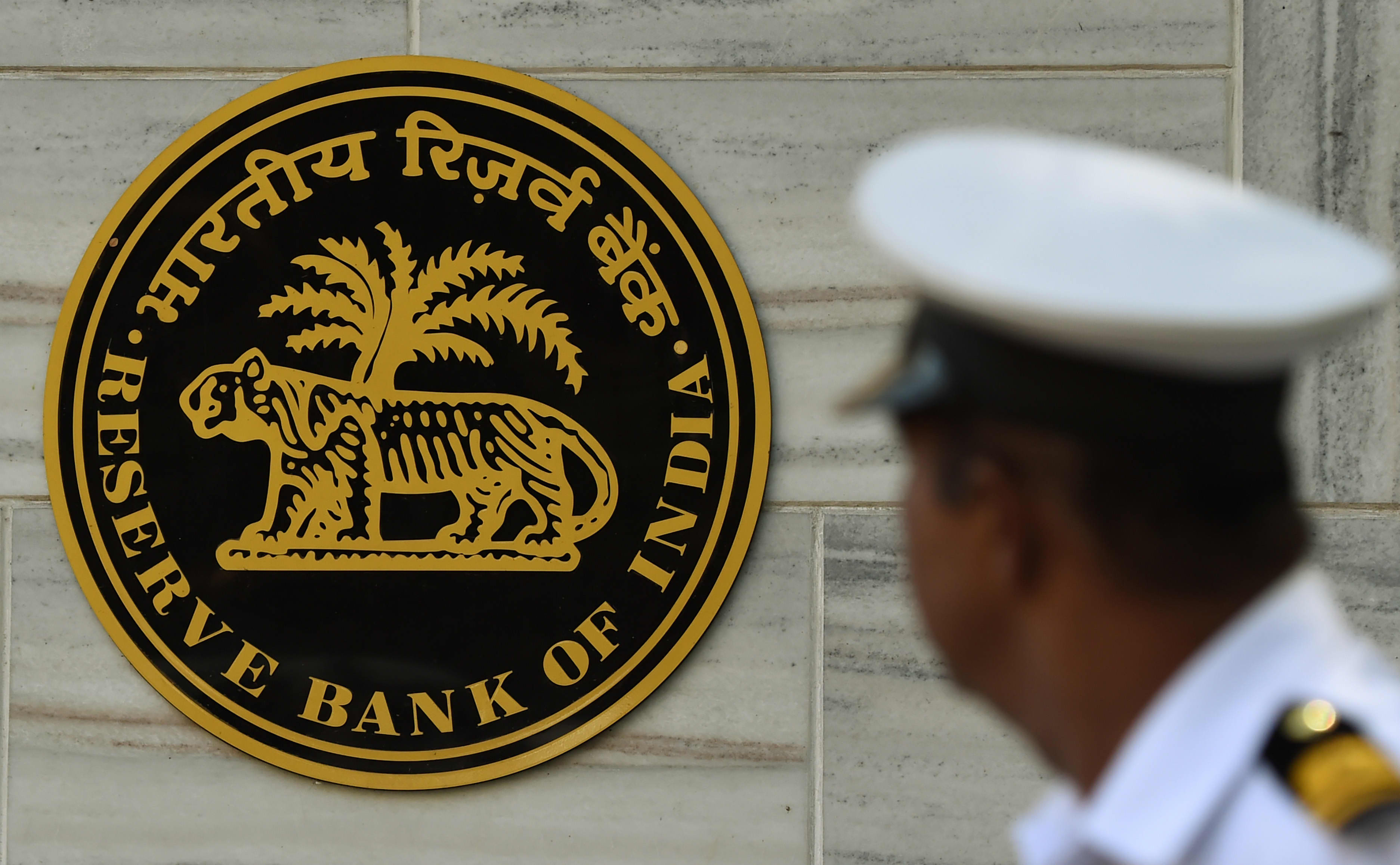 India's central bank unexpectedly keeps interest rates unchanged and slashes GDP forecast