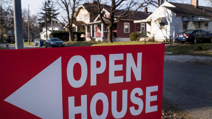 An 'Open House' sign is displayed in the front yard of a home for sale in Columbus, Ohio.