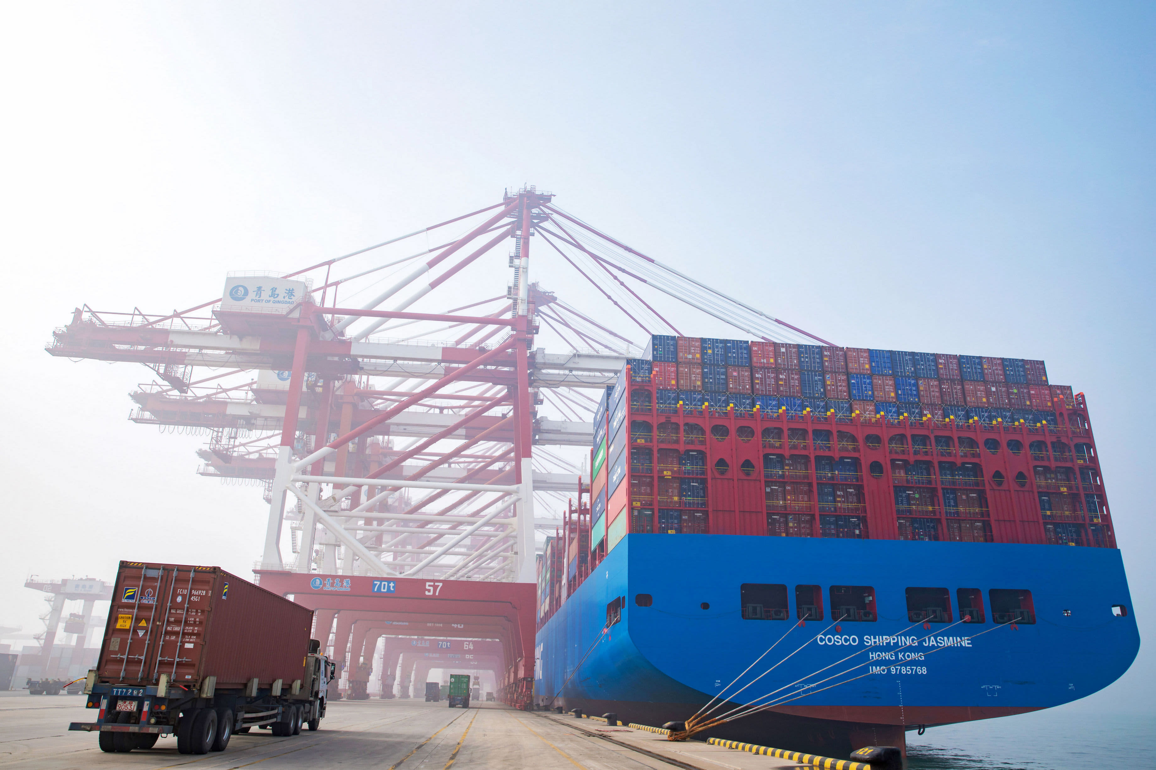 A truck moves a shipping container at Qingdao Port on January 14, 2019 in Qingdao, Shandong Province of China.