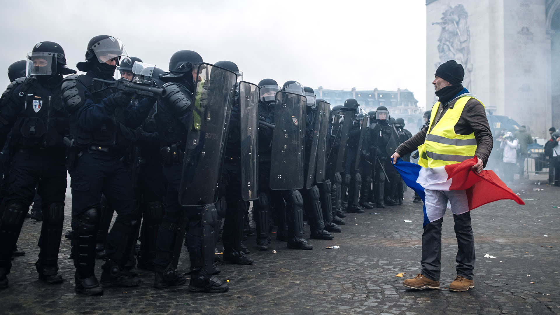 Yellow vests, blue vests and red scarves — Here's why the French are protesting