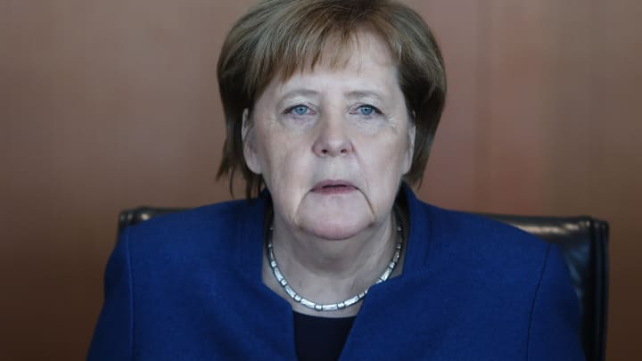 Merkel says she is fine and 'working through' shaking after third bout