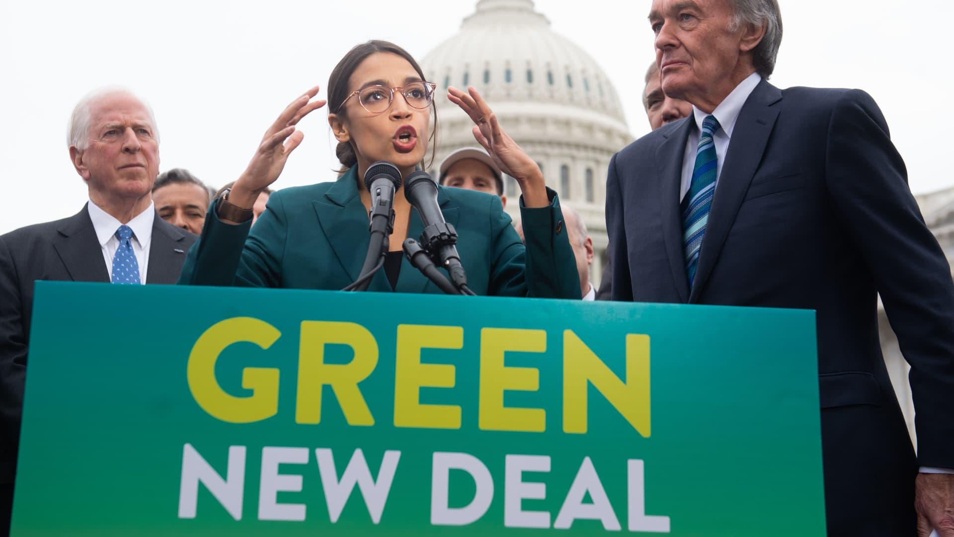Representative Alexandria Ocasio-Cortez, Democrat of New York, and US Senator Ed Markey (R), Democrat of Massachusetts, speak during a press conference to announce Green New Deal legislation to promote clean energy programs outside the US Capitol in Washington, DC, February 7, 2019.