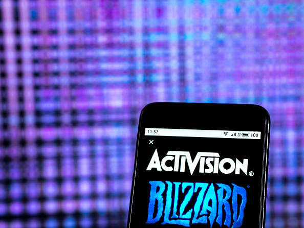 Stocks making the biggest moves midday: Activision Blizzard, Dish Network, Tesla & more