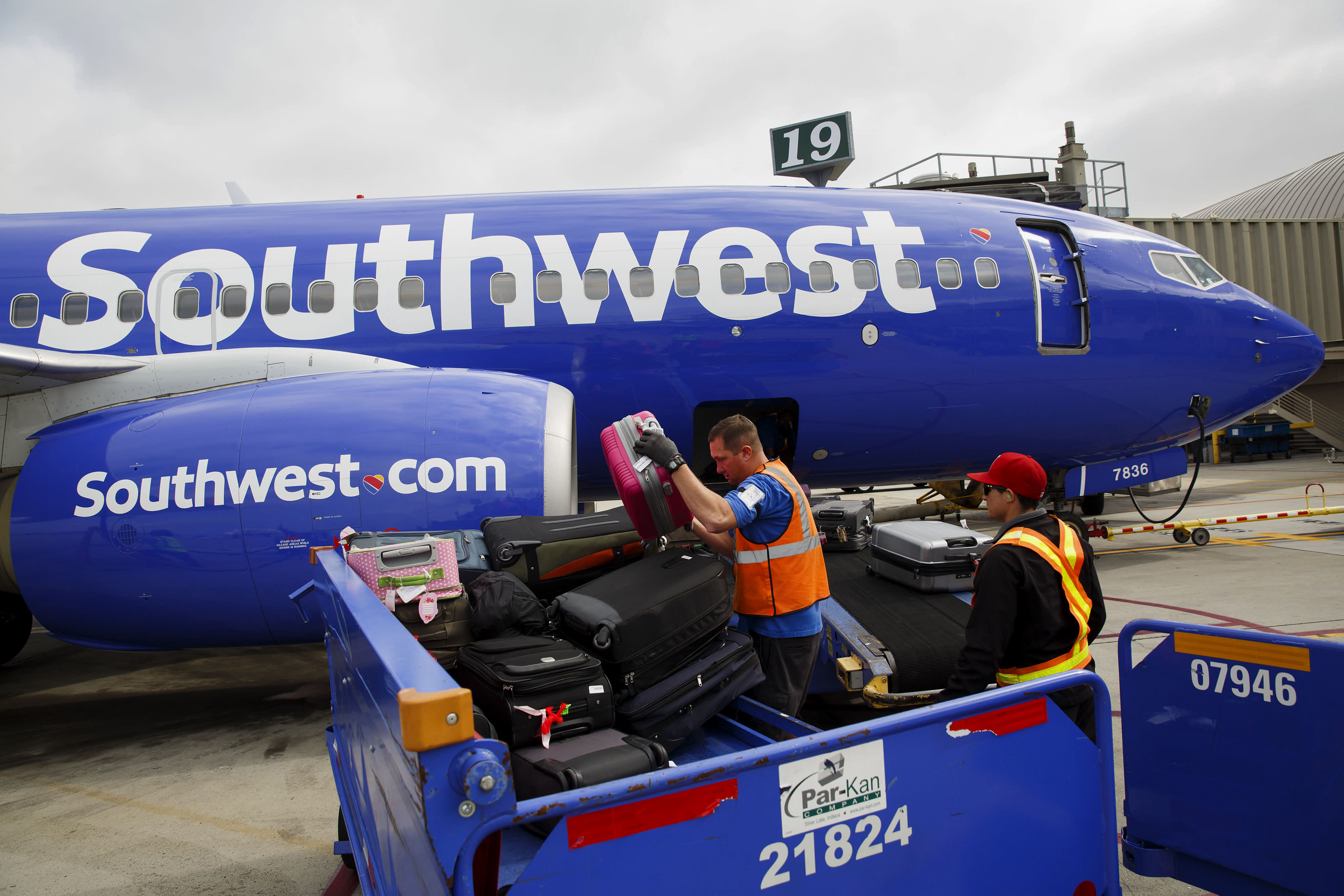 Southwest shares climb on signs of improving demand