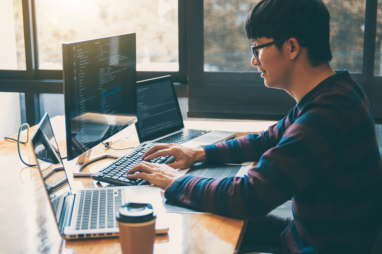 20/20: computer programmer software developer man working on computer