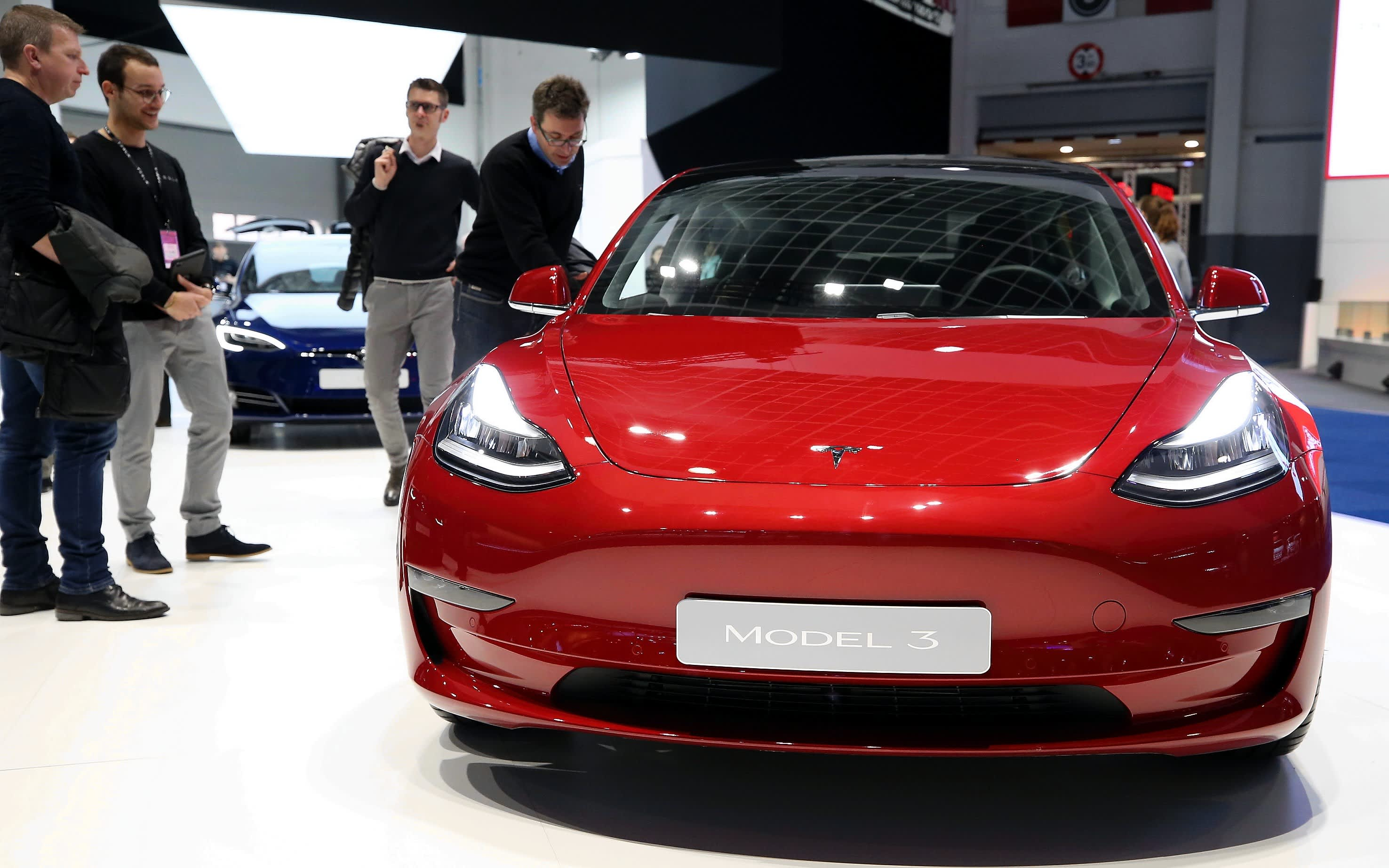 Tesla launches k model with shorter range new interior